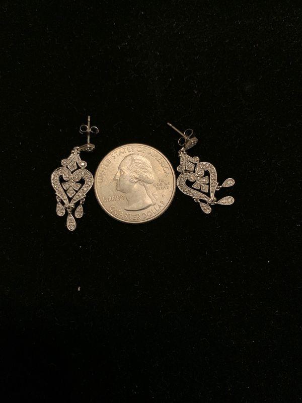 Dangling Diamond Earrings.