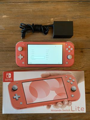 Nintendo switch lite coral pink for Sale in Greenville, SC