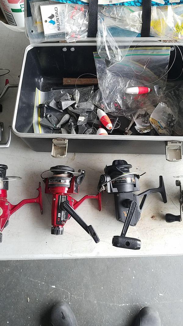 6 reels and box w fishing stuff.