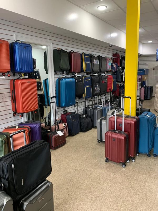 Discounted luggage store travel goods carry on suitcase 50 pounds