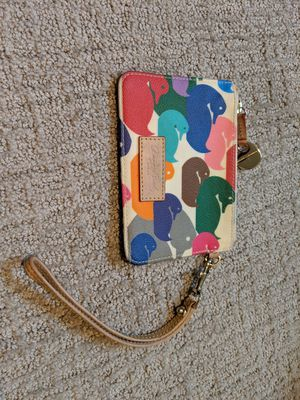 Fun Dooney duck print wristlet for Sale in Seattle, WA