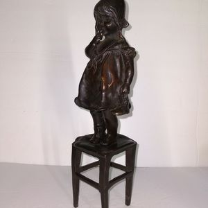 "ANTIQUE SOLID BRONZE INNOCENT LITTLE GIRL CHILD MYSTERY ARTIST SCULPTURE FIGURINE STANDING ON CHAIR WITH ONE SHOE OFF 12"" TALL X 3"" X 3"" for Sale in Pompano Beach, FL"