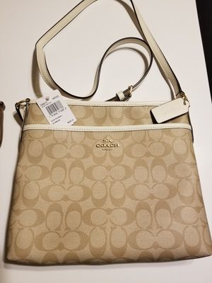 NEW WITH TAGS COACH CROSSBODY! TAN AND WHITE COLORED! $120 FIRM PRICE! PRECIO FIRME! for Sale in Garland, TX