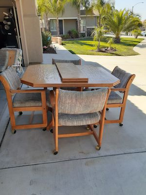( Not free make me offer) antique dining room table and 4 wheels on chairs for Sale in Winchester, CA