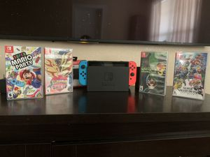 Switch, 4 games, and a new extra wireless controller. for Sale in Clearwater, FL