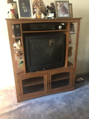 Tv entertainment center. Nice. Good condition. With glass shelves on the side. Items on stand not included. $40 for Sale in Byron, CA