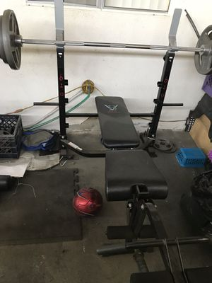 Weight bench and Olympic bar with weight plates for Sale in Anaheim, CA