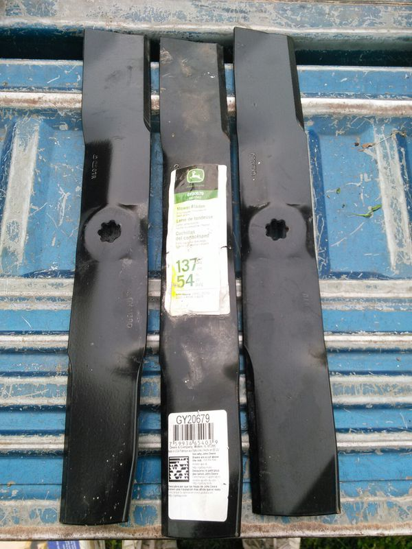 Brand new riding lawn mower blades for a 54 inch John Deere riding lawn mower