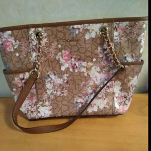 Calvin Klein handbag purse shoulder bag tote Like new besides a small mascara stain on the inside. Outside is in perfect condition. This bag is beauti for Sale in Huttonsville, WV