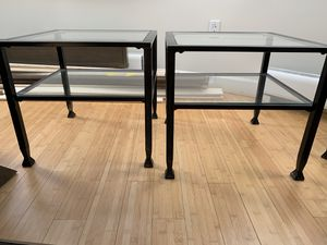 2 heavy metal (wrought iron?) and glass square end / side table tables black with extra shelves under top glass. Very nice. Dimensions 20 x 20 x 18H for Sale in Arlington, VA