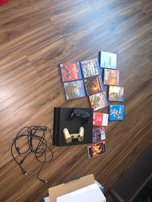 Play station 4 with 2 controllers and games. Also with Nintendo games and my Sony Bluetooth noise cancellation headphones. for Sale in Joliet, IL