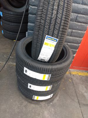 Set of new four tires Goodyear 215 45 17 free professional installation for Sale in Buena Park, CA