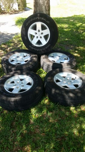 Jeep Wrangler Wheels, tires, TPMS sensors (all working) X 5 for Sale in Safety Harbor, FL