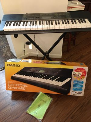 Casio Electronic Keyboard CTK-2080 in Excellent Working & Cosmetic Condition. Original Box, Song Book, Stand and AC charger. $110 OBO. for Sale in Boynton Beach, FL