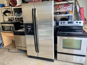 Whirlpool Stainless Steel Appliances Set Side by Side Refrigerator, Electric Ceramic Top Stove, Over the Range Microwave and Dishwasher READ ENTIRE AD for Sale in Gilbert, AZ