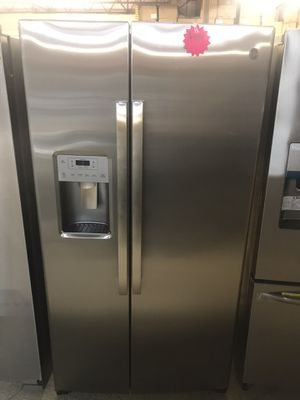 GE side by side stainless steel refrigerator for Sale in Columbus, OH