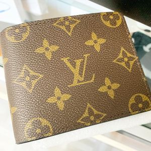 Louis Vuitton wallet Brand new sealed in box and in Louis Vuitton bag. for Sale in Bellflower, CA