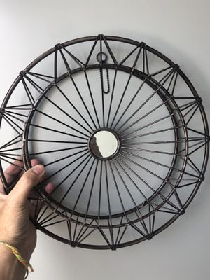 Black Decorative Wall Circle with a mirror in center for Sale in Los Angeles, CA