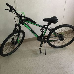 Huffy green and black nighthawk mountain bike for teens for Sale in Derwood, MD