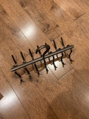 Brown hanger , metal. Has 14 hanging spaces. New for Sale in Los Angeles, CA