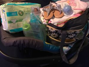 Baby bundle. Includes car seat, diaper bag, pampers, and girls clothes ranging from 0-3 months. And shoes for Sale in College Park, GA