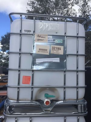 275 gallon capacity water containers with hose connection and shut off valve at the bottom for Sale in Fort Pierce, FL