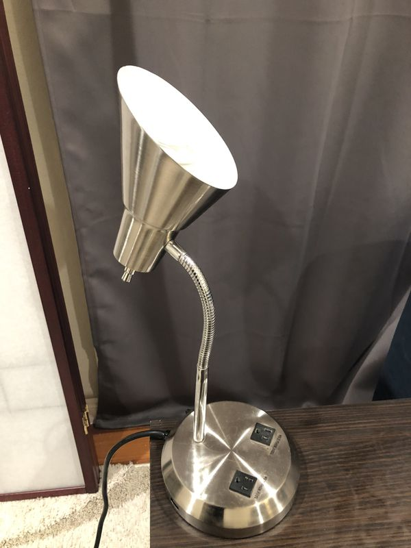 Metal desk lamp with two outlet ports