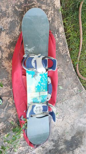Burton womens snowboard with burton bindings and burton travel bag for Sale in Phoenix, AZ