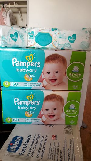 Pampers baby dry size 4 bundle :has2boxes of 150 diapers each box +3 wipes for Sale in Perris, CA