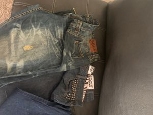 Akoo and truck fit jeans for Sale in Evansville, IN