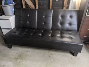 Leather futon couch with armrest and cup holder, 1 years old for Sale in Riverside, CA