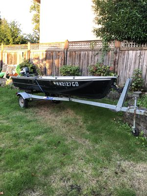 14 foot aluminum boat with trailer and a 7.5 hp classic Evinrude Motor includes gas line and gas tank for Sale in Seattle, WA