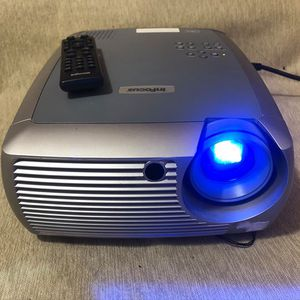 InFocus X2 DLP SVGA Home Theater Projector W/ remote ONLY 79 HRS USED THAT CAN GO UP TO 4000 HRS for Sale in Carrollton, TX
