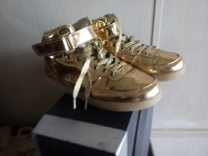 New 6 1/2 gold womens shoes for Sale in Olathe, CO