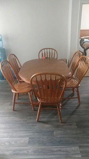 Oak formica table with 6 chairs and extra leaf for Sale in Chandler, AZ