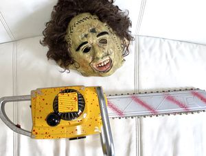 Leather face Halloween mask includes Toy bloody chainsaw for Sale in Miami, FL