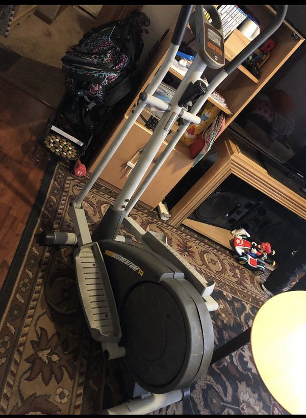 2 end tables, 2 big lamps, 1 coffee table and elliptical