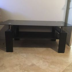 Coffee Table with Black Glass Top and Shelf for Sale in San Diego,  CA