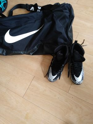 Football cleats size 3 in the bag for Sale in St. Louis, MO