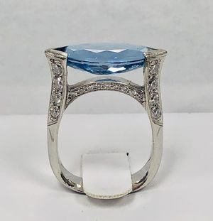 Authentic Platinum Ring with 18 real Diamonds in the sides & 18 in the Middle and Stunning Oval Blue Stone on Top. Weight 12.9g.- Size 7 for Sale in Miami, FL