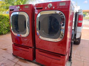 LG RED STEAM WASHER AND ELECTRIC STEAM DRYER SUPERCAPACITY WITH PEDESTALS for Sale in Hialeah, FL