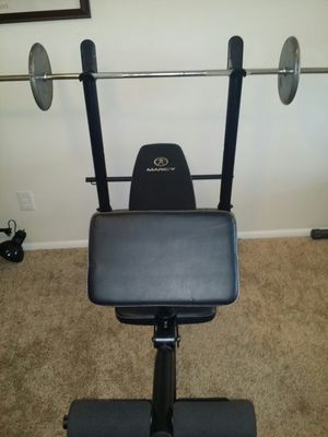 Marcy heavy duty weight bench that does regular, decline and 2 incline positions. Has preacher curl pad and leg press. 6 foot chrome barbell for Sale in Coconut Creek, FL