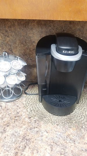 Keurig coffee maker with coffee holder for Sale in Columbus, GA