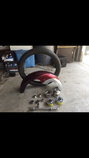 21 inch narrow glide aftermarket mag wheel with extra tire and wrap fender and hubs Will fit Harley Davidson motorcycle for $450 firm for Sale in Chicago, IL