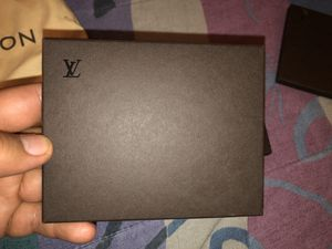 LOUIS VUITTON ENVELOPE WITH PAMPHLET OF DIFFERENT WAYS TO WEAR SCARF. for Sale in The Bronx, NY