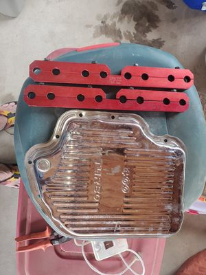 Turbo 400 chrome trans pan and 350 chevy girdles 75 for both for Sale in Fresno, CA