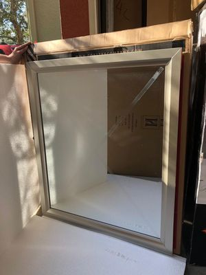 Silver frame mirror new in boxes with the hardware for the wall or the dresser for $49 for Sale in Kissimmee, FL