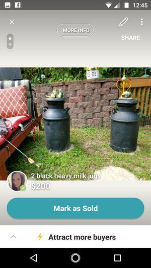 2 black excellent condition heavy milk jugs for Sale in Rhinelander, WI