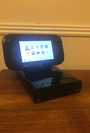 Nintendo Wii U with loaded games, gamepad, and charging dock for Sale in Mesa, AZ