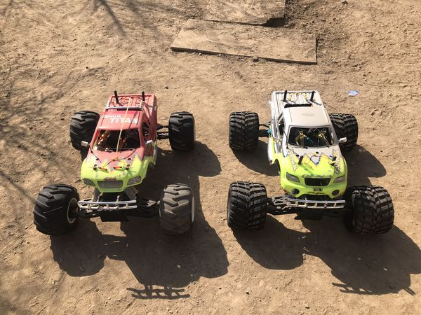 $700 Only the grey truck is 4 sell Runs like new ofna twin titan 1/8 scale 4x4 monster truck twin nitro motors has upgrades very fast truck